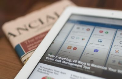 A tablet on a news paper